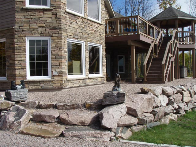 House with nice wall of stone retaining stone