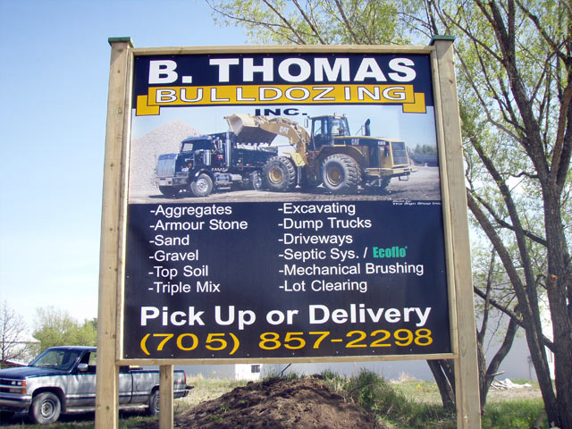 B Thomas Bulldozing sign