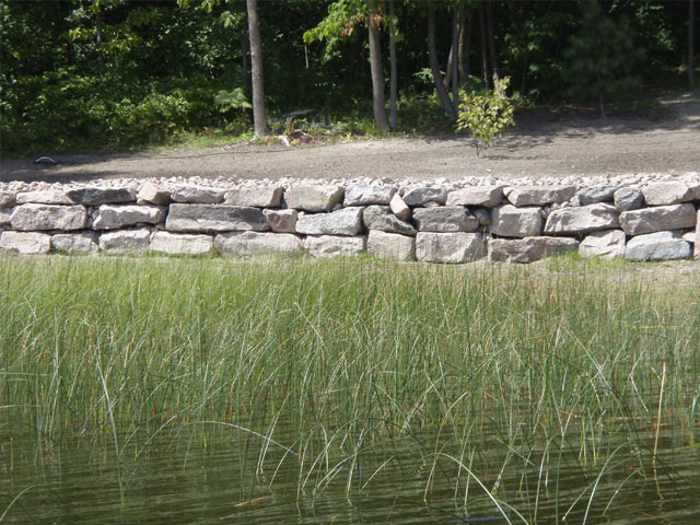 Low stone wall at the edge of a body of water
